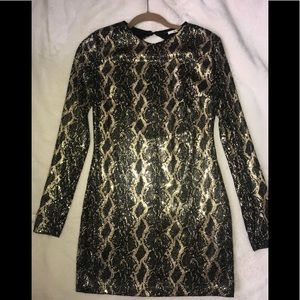 Snake skin long sleeved open back dress